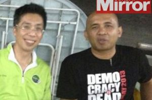 Pilot of missing plane Zaharie Ahmad Shahs  in a Democracy is Dead t-shirt.